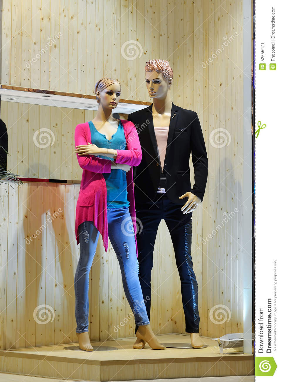 man and woman mannequin in fashion shop window stock photo