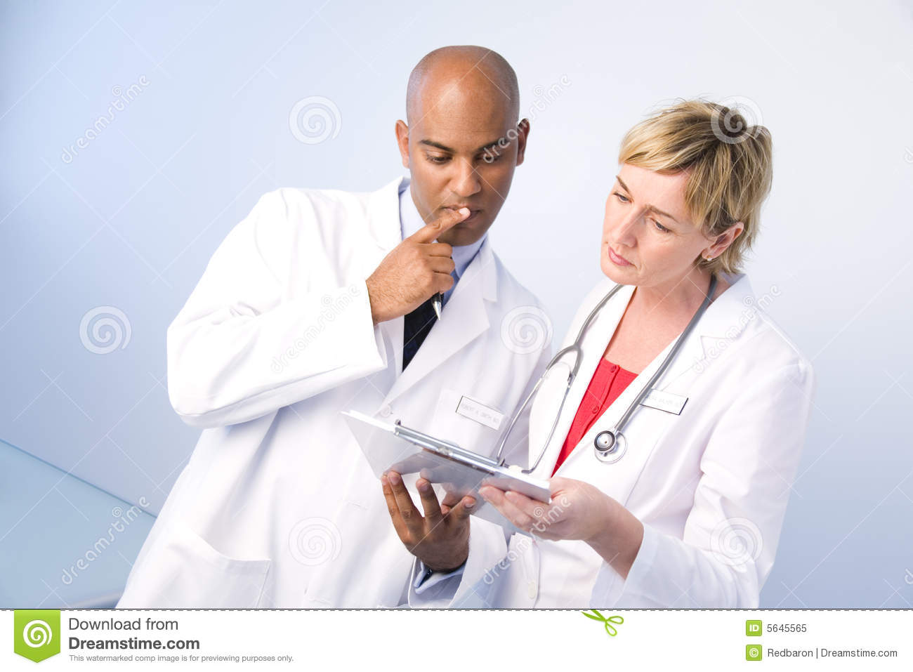 Man and woman physicians