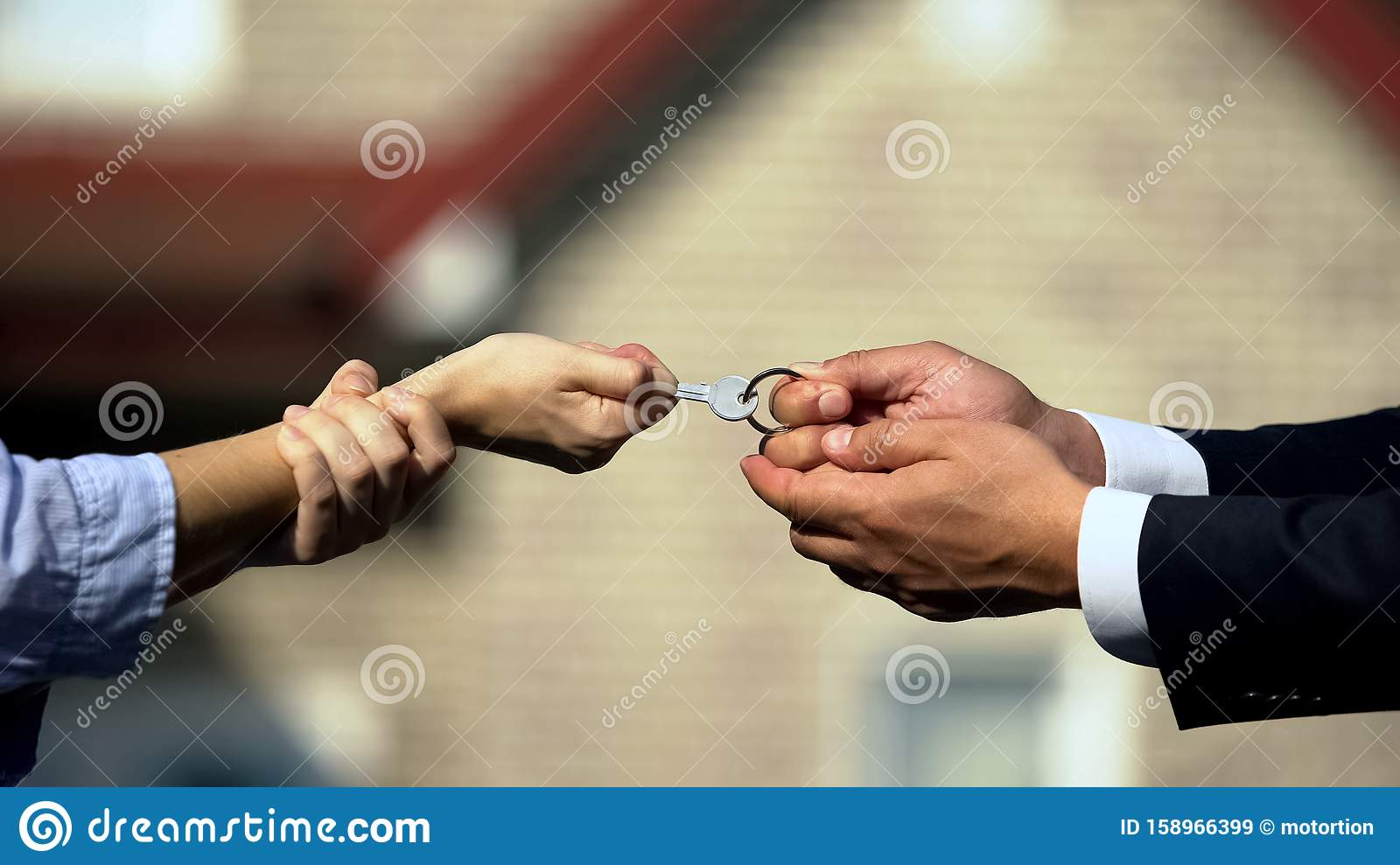 Man And Woman Pulling Key From House, Division Of Property