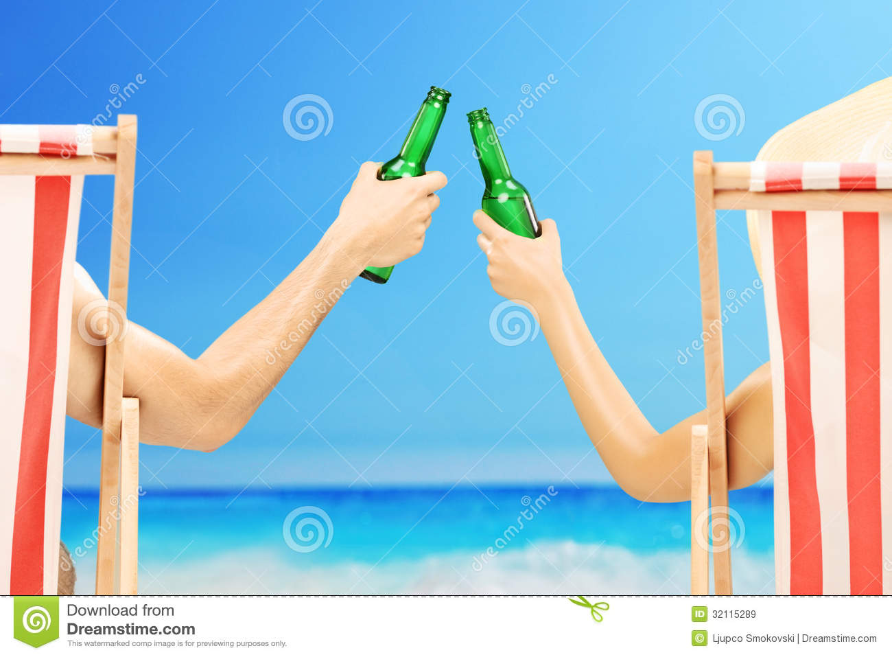 Man And Woman Relaxing On A Beach And Cheering With Beer