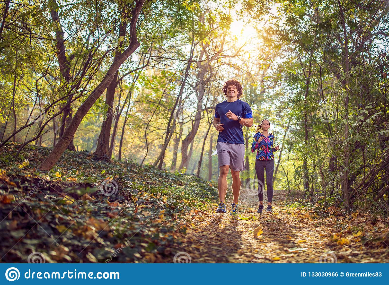 Man and woman running at the nature- fitness, sport, training an