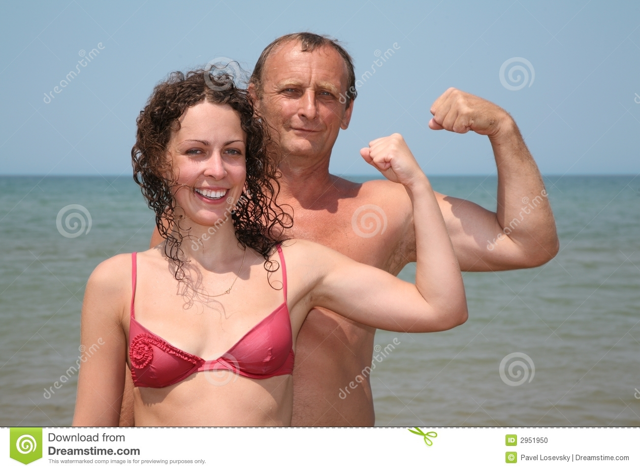 Man and woman show bicepses