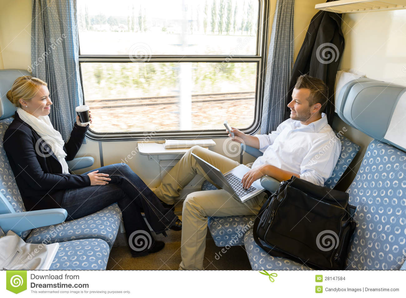 Man eating out woman on train