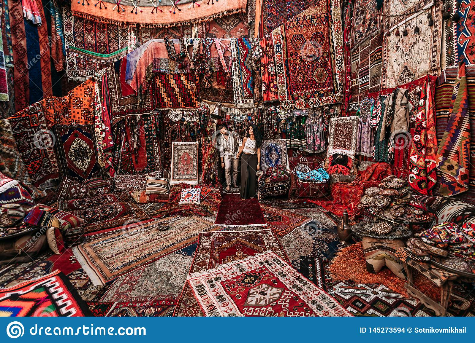 Man and woman in the store. Couple in love in Turkey. Man and woman in the Eastern country. Gift shop. A couple in love travels.