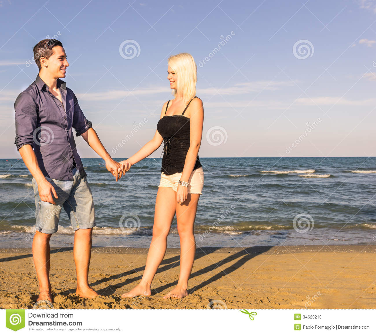 Woman walking on a beach royalty - Royalty Free Stock Photo Download Man And Woman Walking
