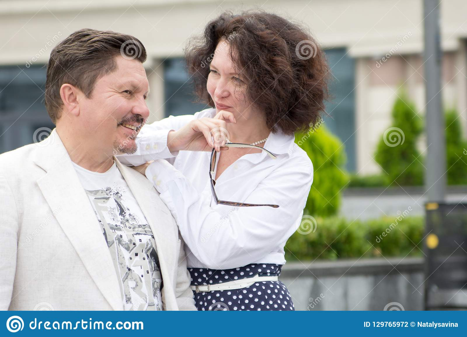Business style Office middle-aged couple man woman outdoors