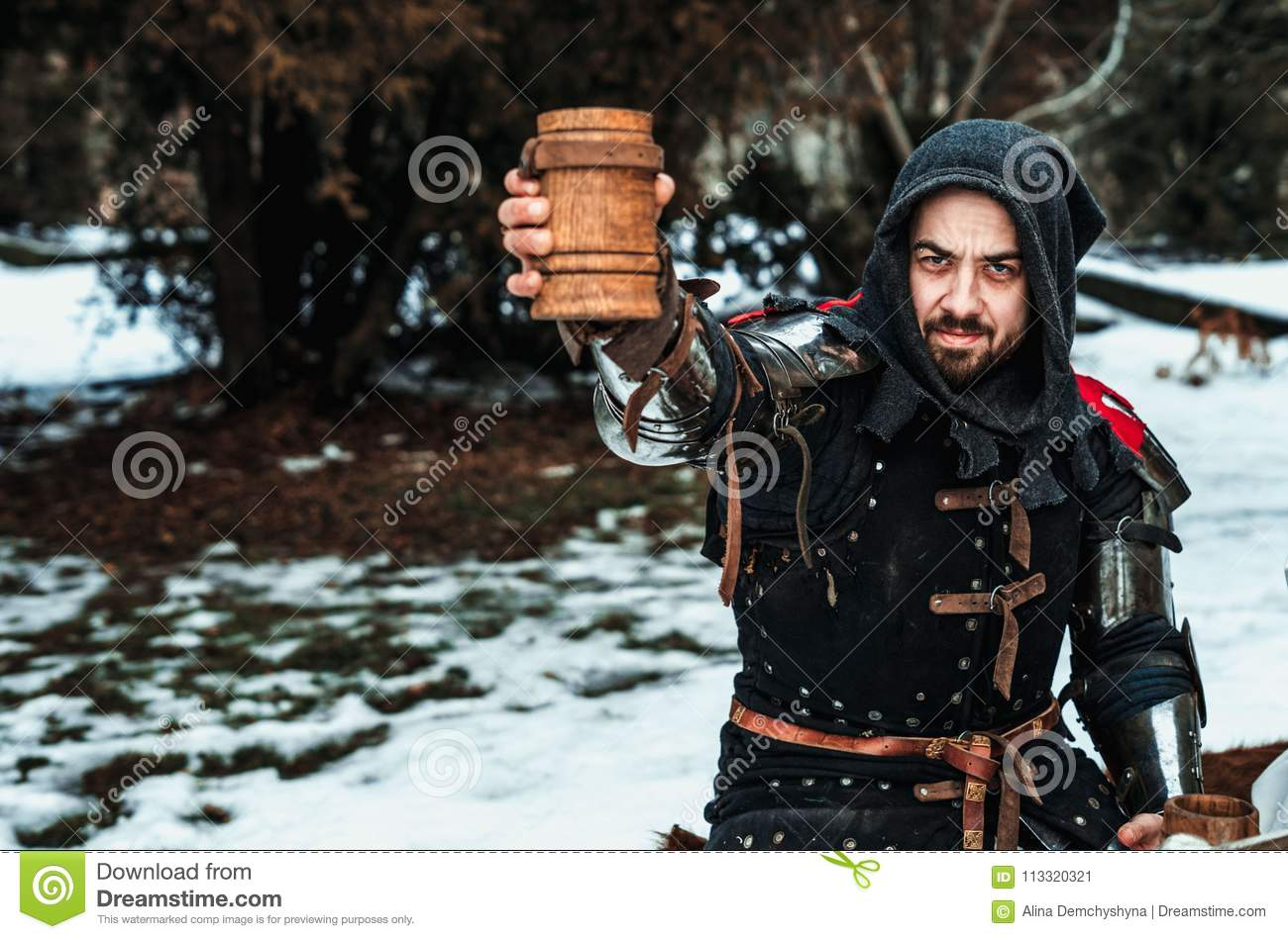 Man with a wooden glass