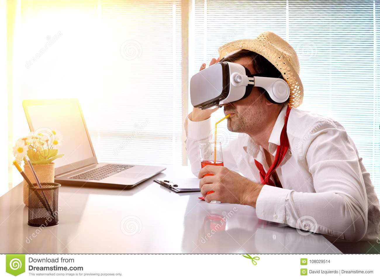 Man at work imagining his vacation with vr glasses drinking