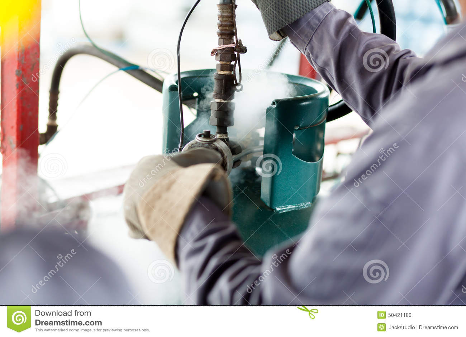 Man Work A Propane Tank Stock Photo - Image: 50421180