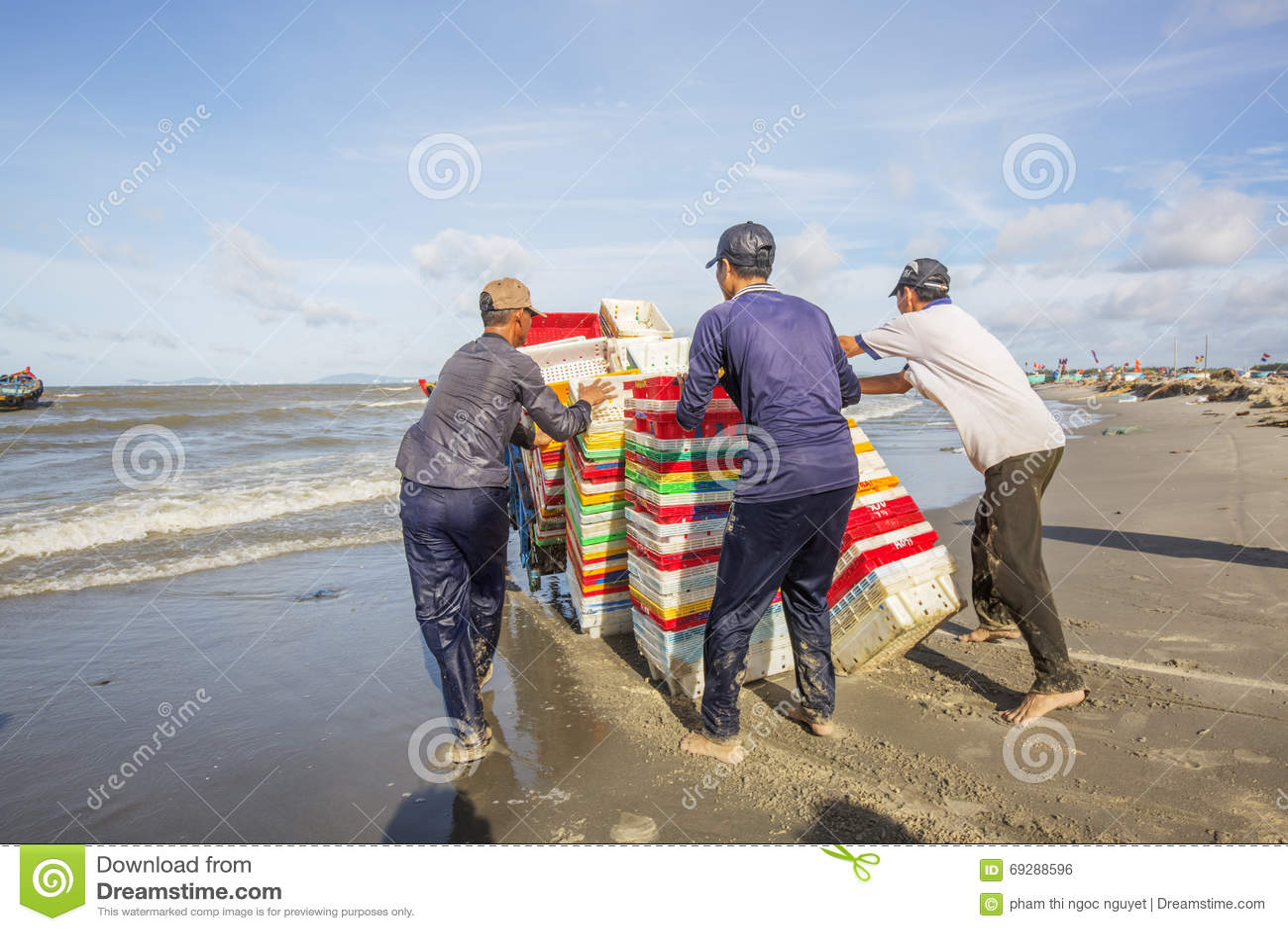 Man working on the beach near long hai fish market for Long beach fish market