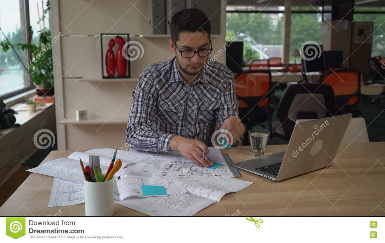 Man working with blueprint architectural sketch in the design man working with blueprint architectural sketch in the design agency stock video video 73294715 malvernweather Images