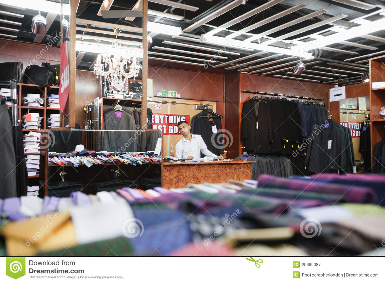 Royalty Free Stock Photography: Man working in a clothing store
