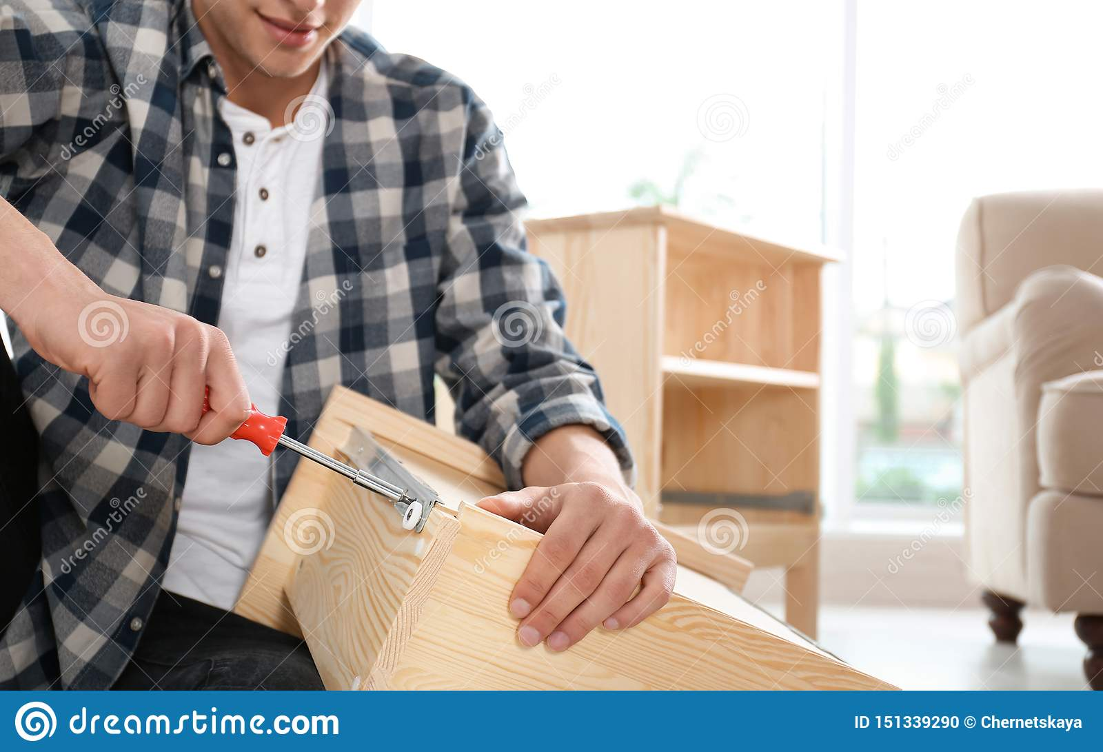 Man working with drawer indoors. Space for text