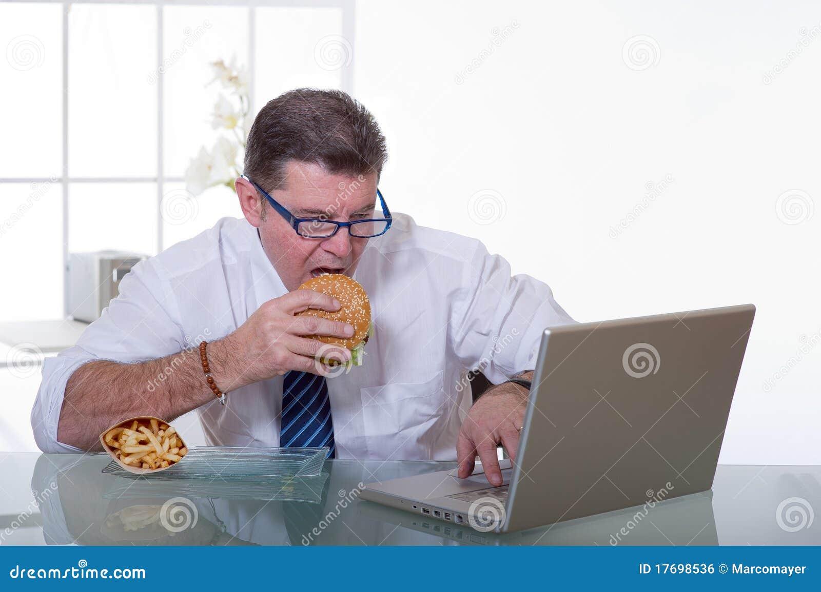 Man working and eat unhealt food