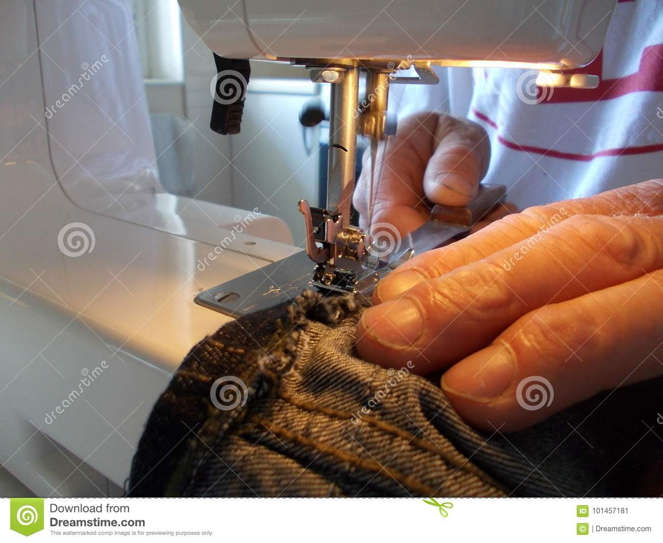 man working with an electrical sewing machine in a home business