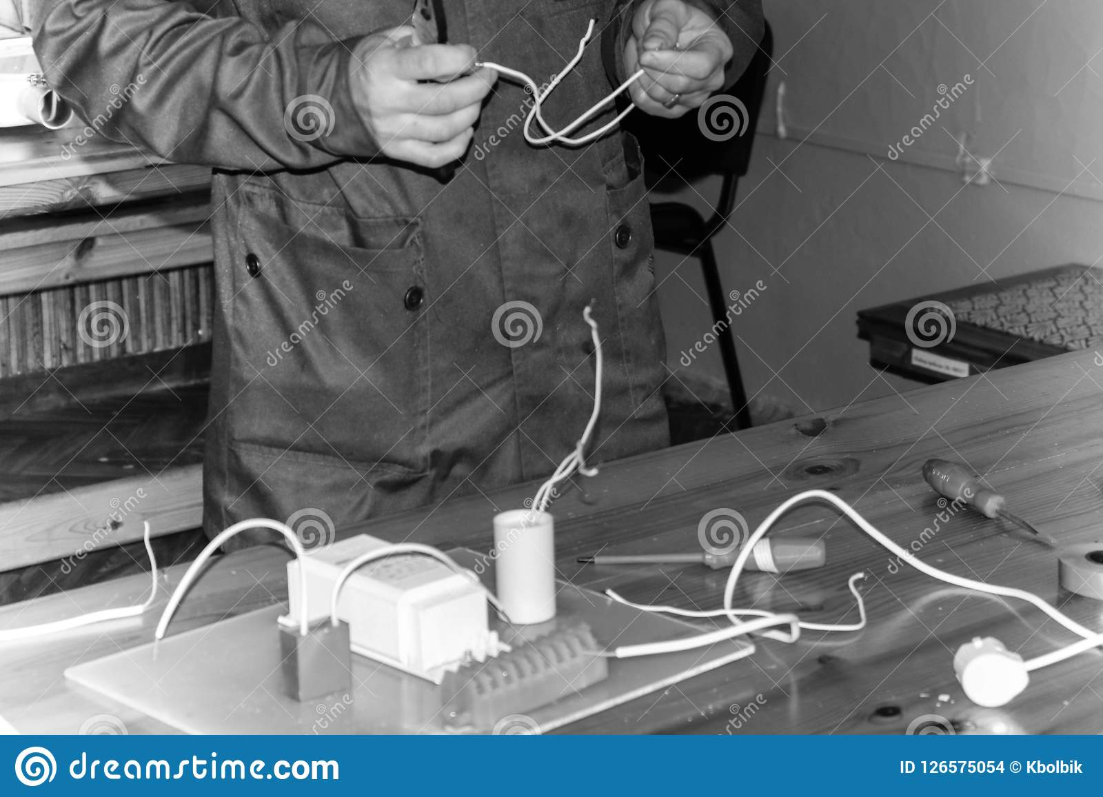 Awe Inspiring A Man Working Electrician Works Collects The Electric Circuit Of A Wiring Digital Resources Instshebarightsorg