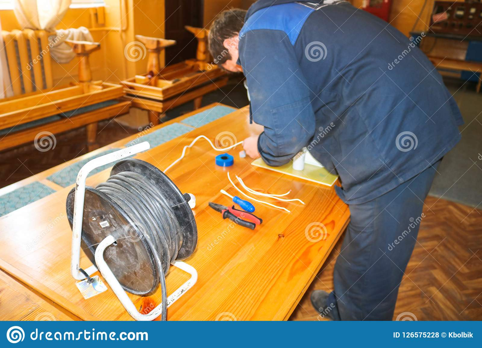 Prime A Man Working Electrician Works Collects The Electric Circuit Of A Wiring Digital Resources Instshebarightsorg