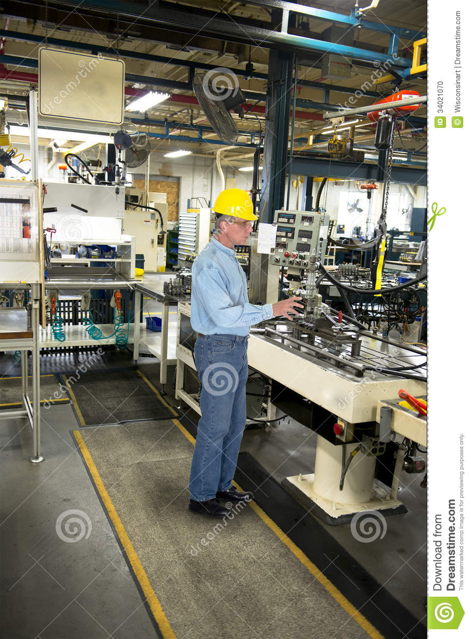 man working in industrial manufacturing factory stock photo man working in industrial manufacturing factory