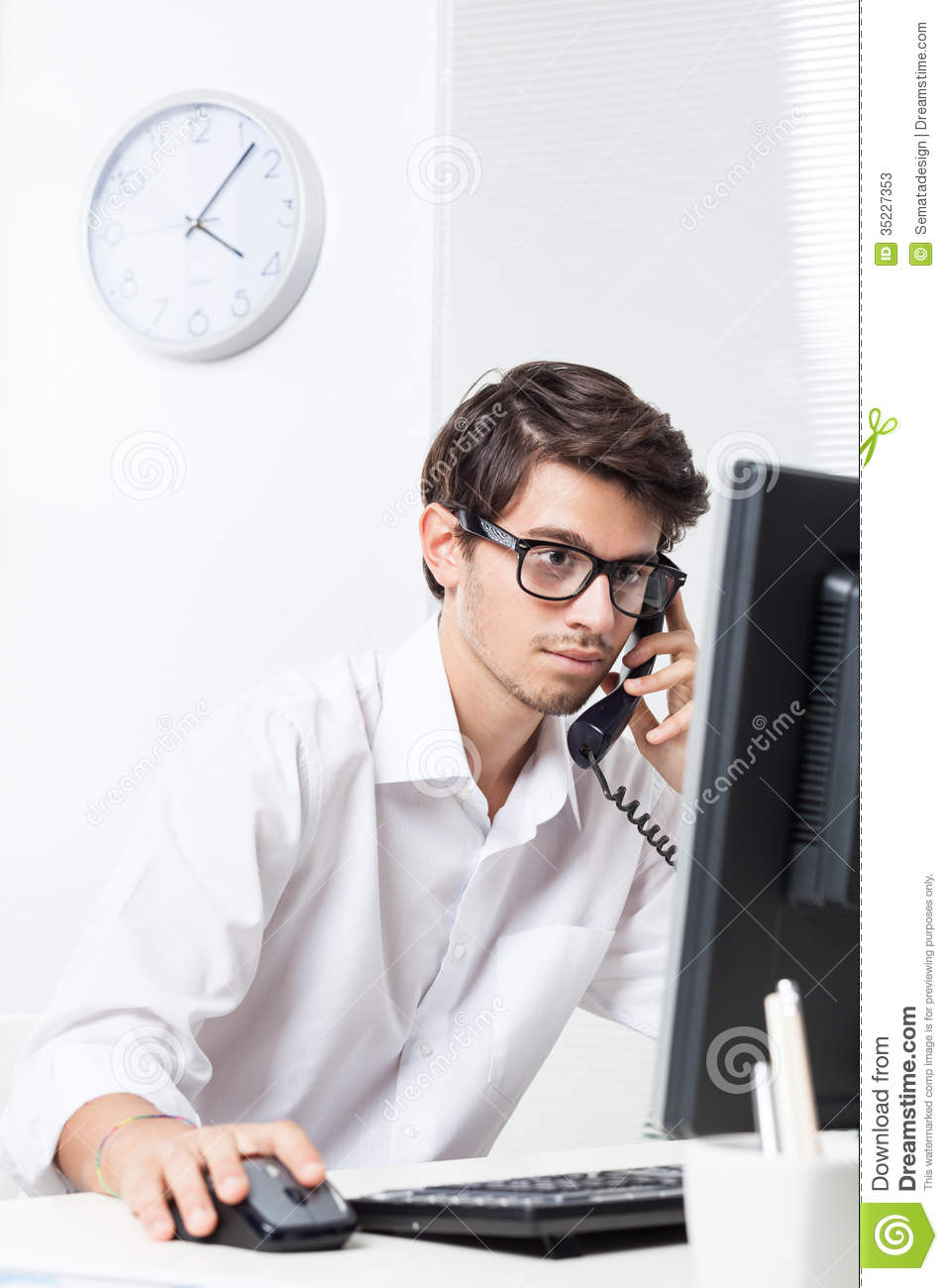 Man Working In Office On The Phone Stock Photos Image