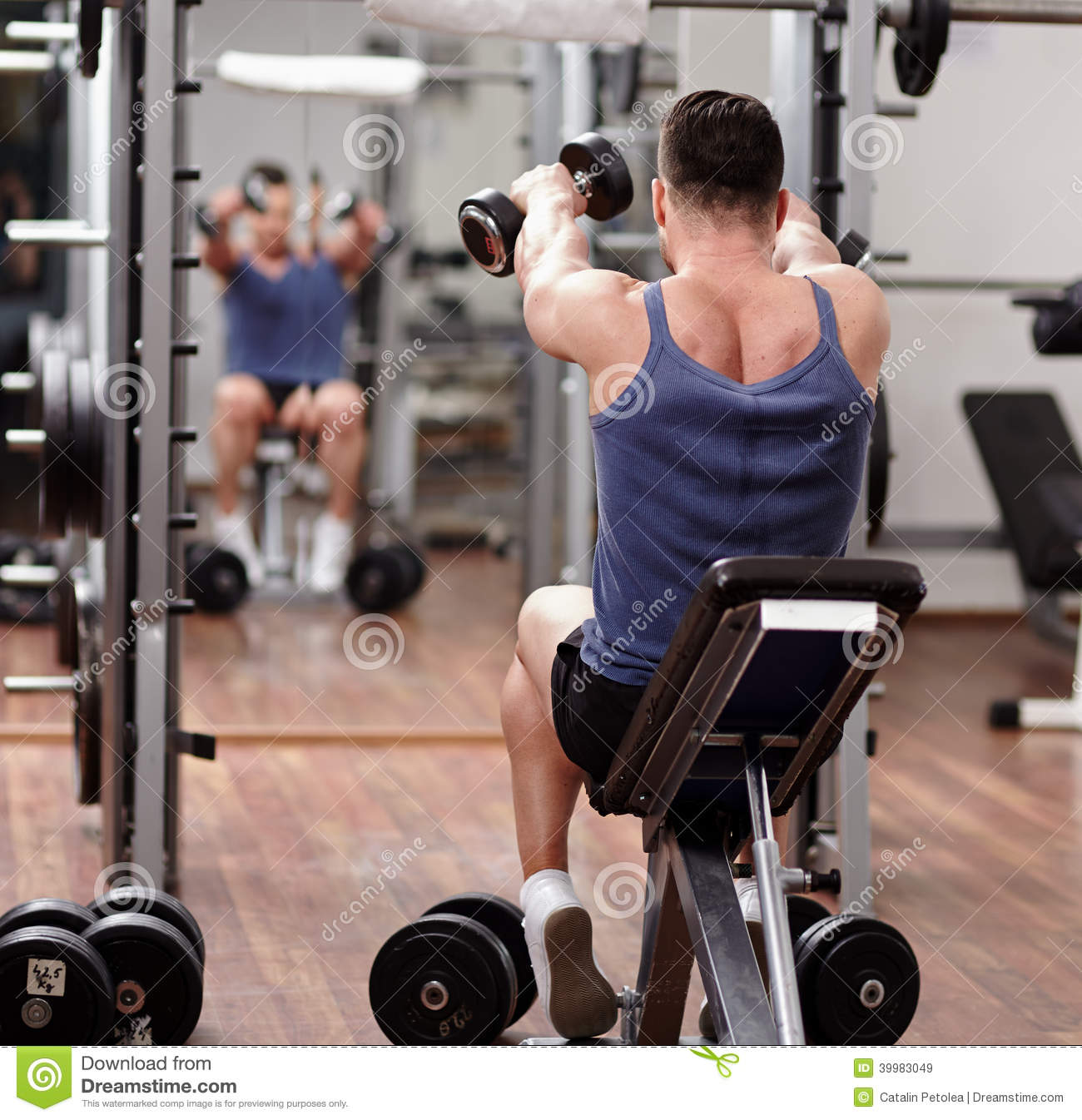 Working Out: Man Working Out In Front Of The Mirror Stock Photo