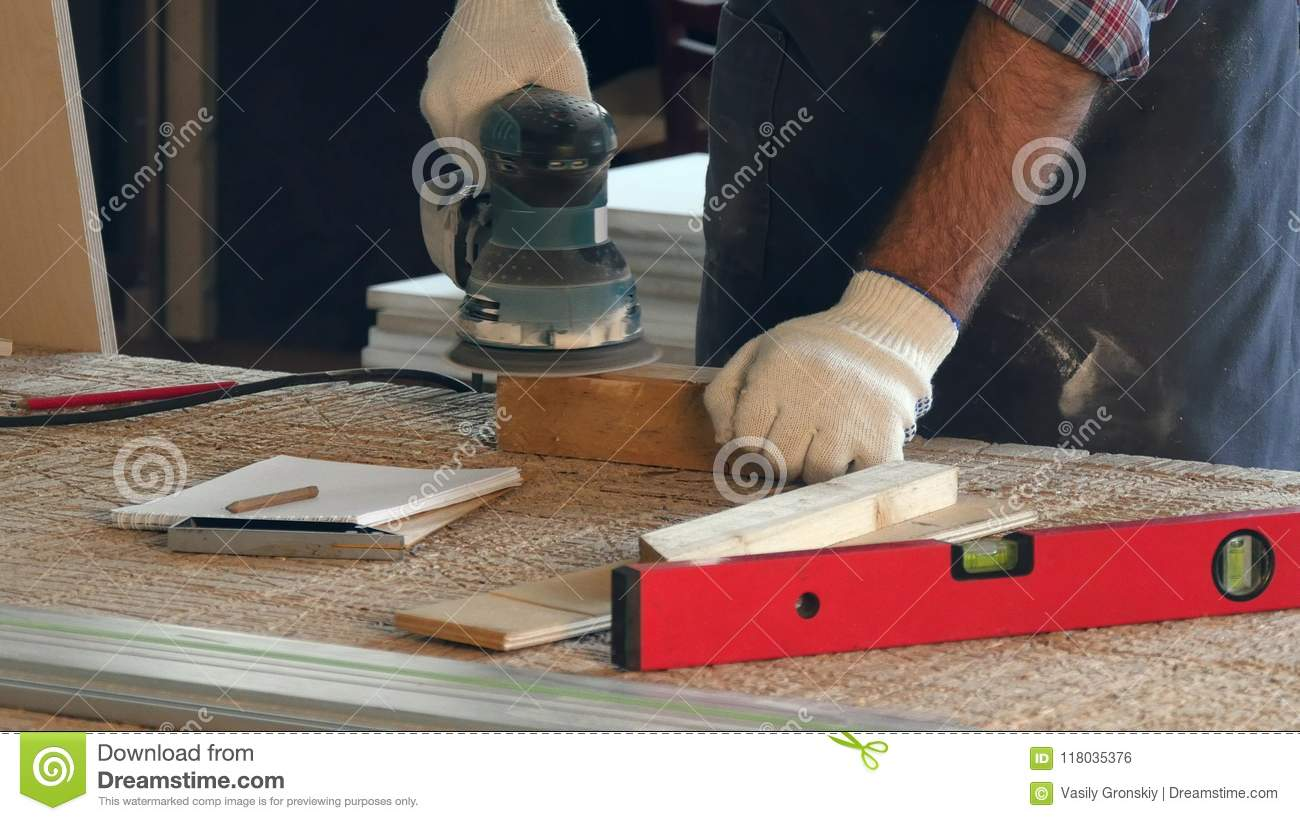 Man Working With Wooden Planck And Electric Planer In Workshop What Does An Do