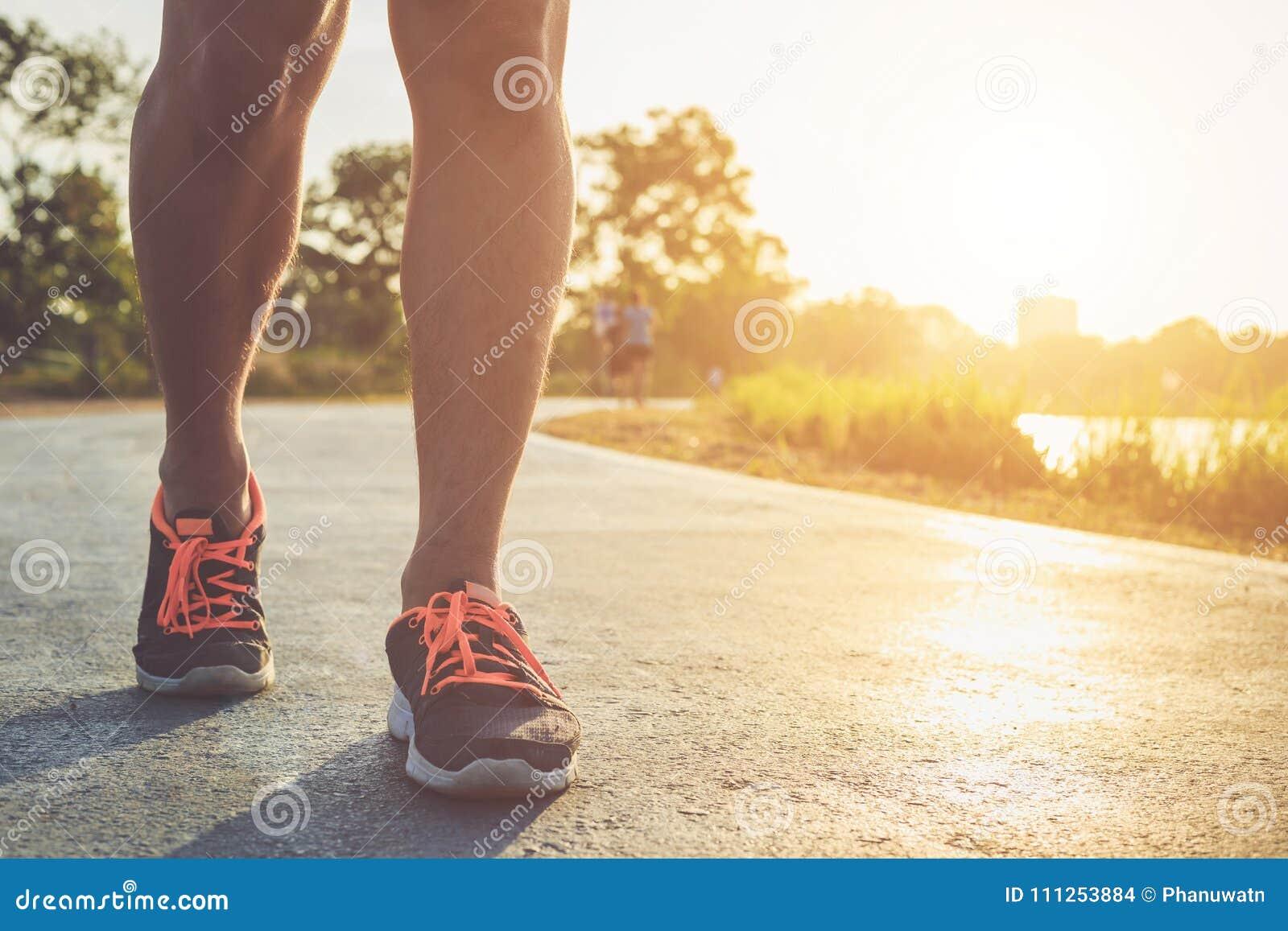 Man workout wellness concept : Runner feet with sneaker shoe run