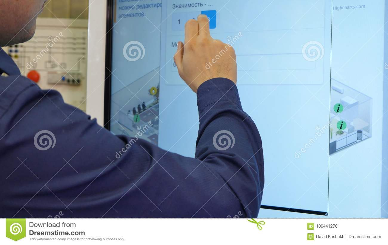 Man Works On A Touch Screen  Young Scientist Uses A Large
