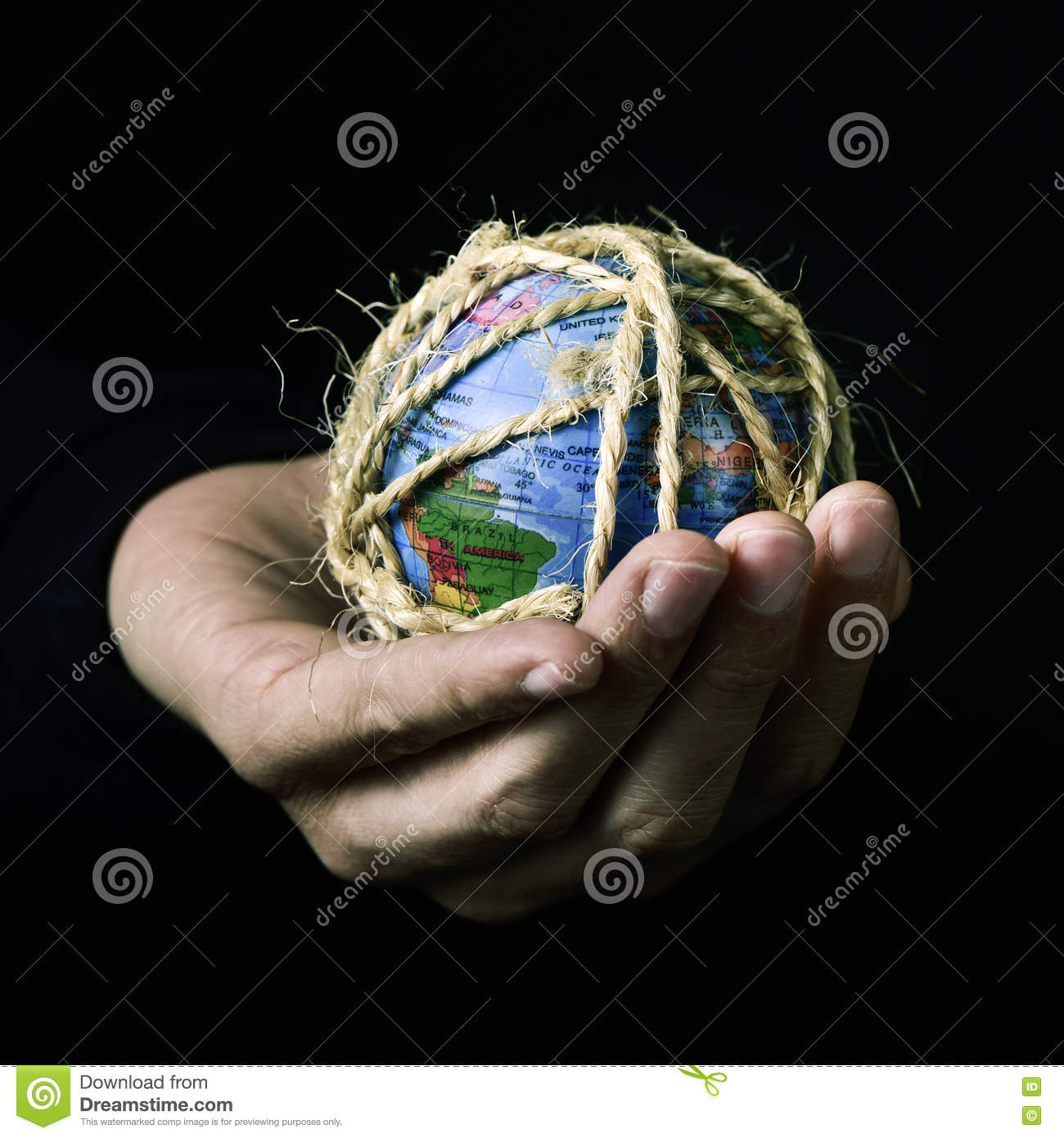 Man with a world globe tied with rope