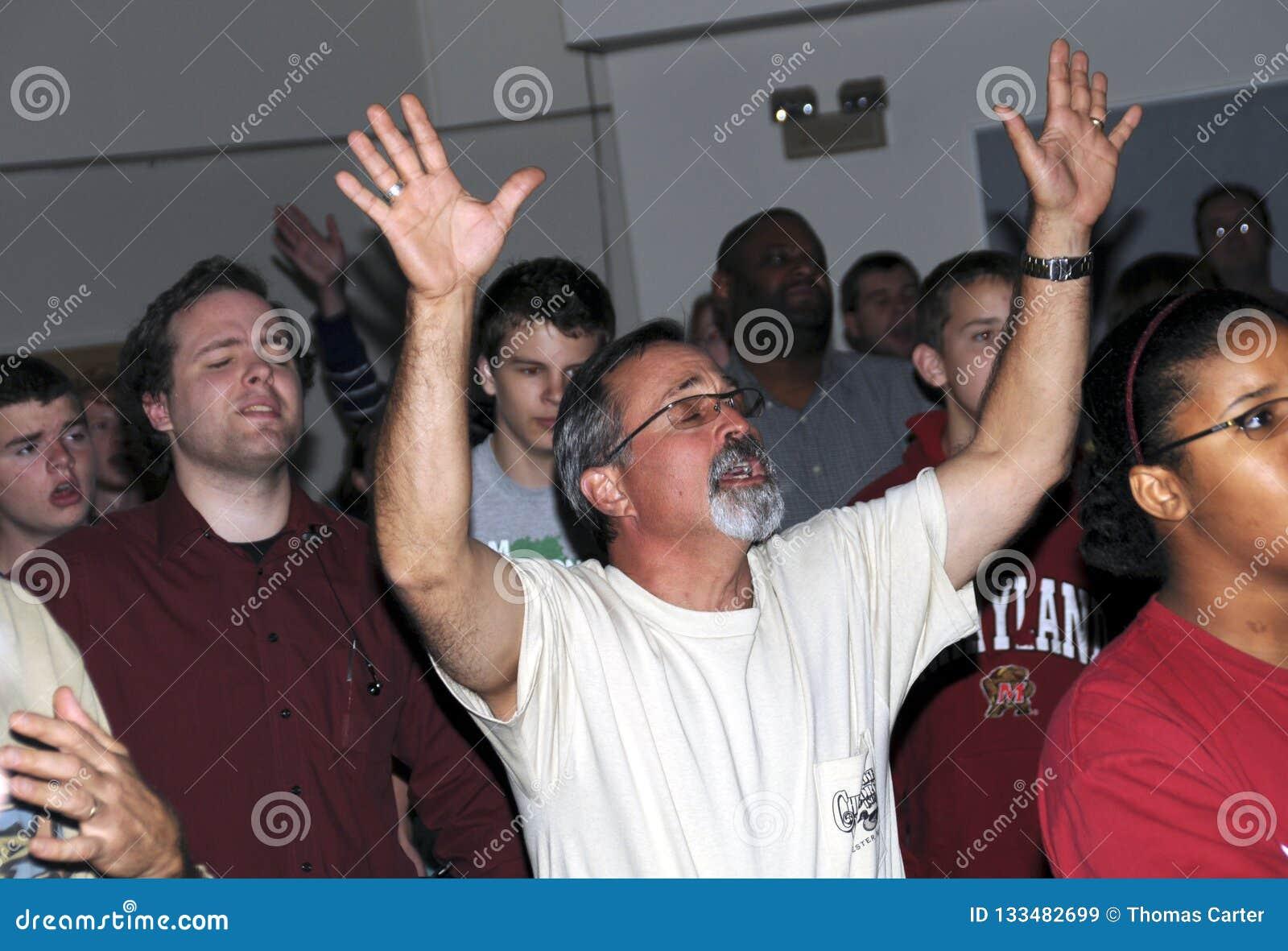 Man worships God in a church service