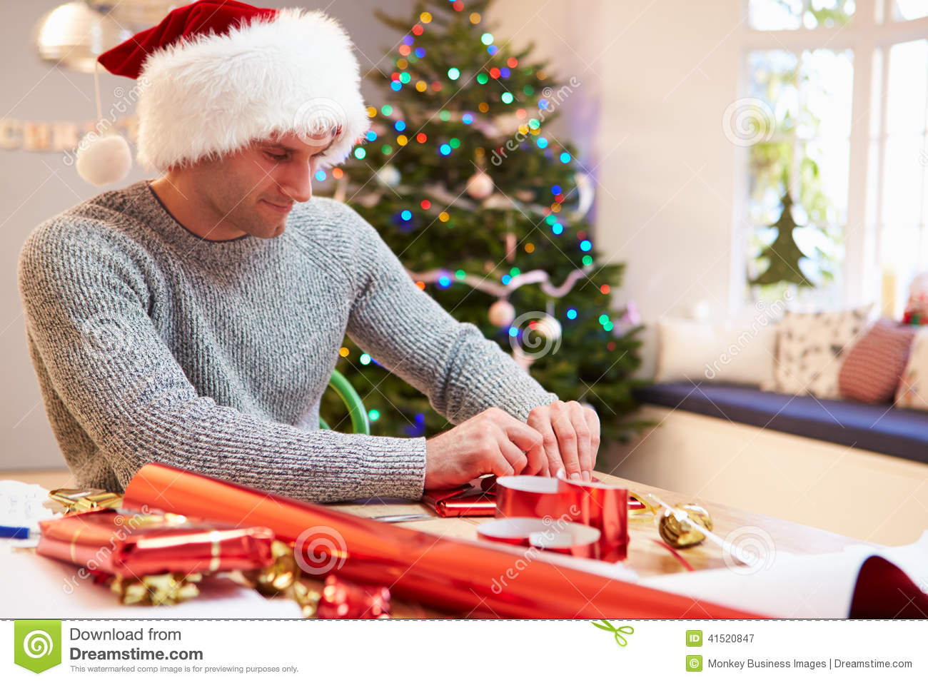 Man Wrapping Christmas Gifts At Home Stock Image - Image ...
