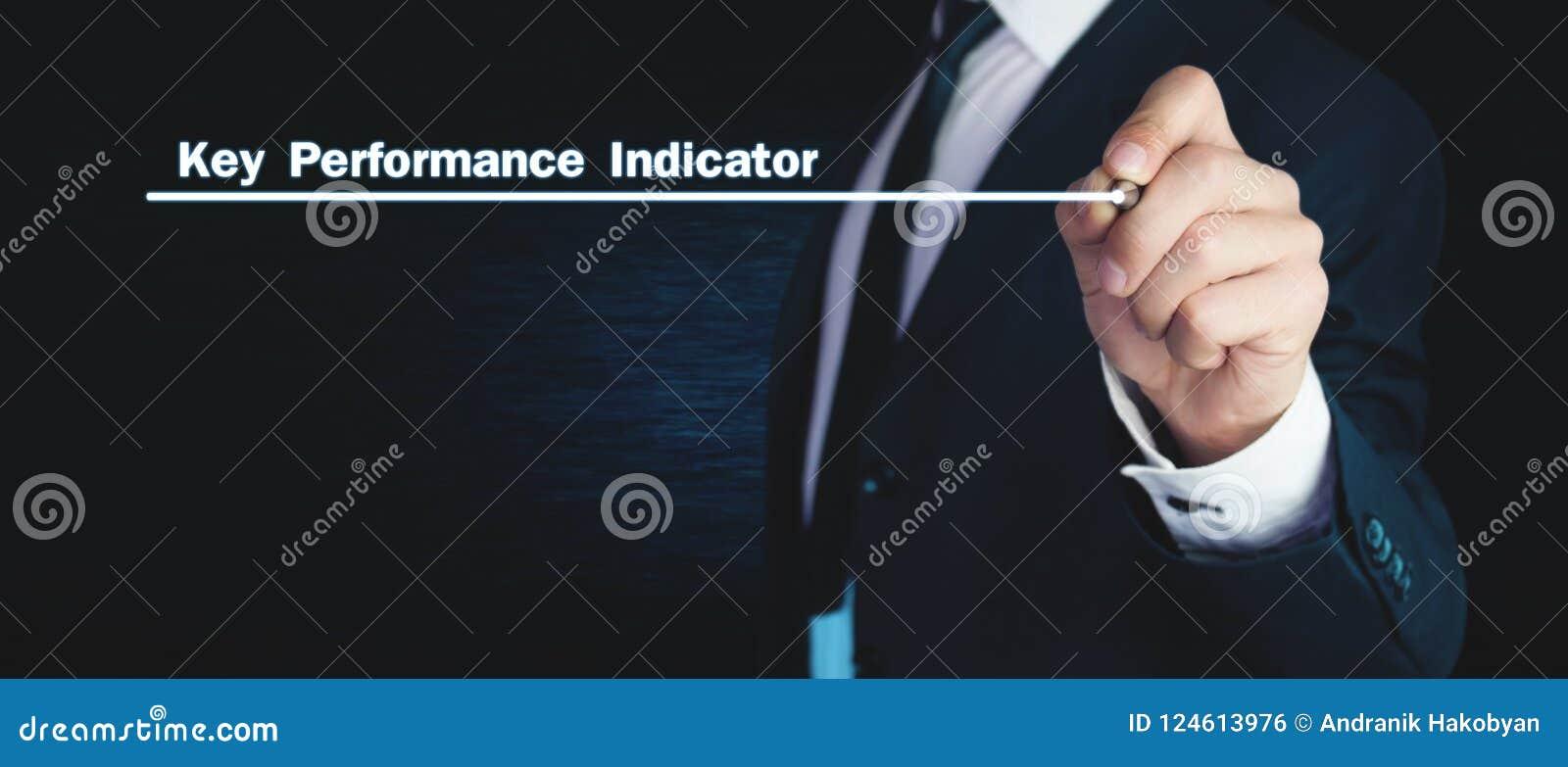 Man writes Key Performance Indicator text on screen.