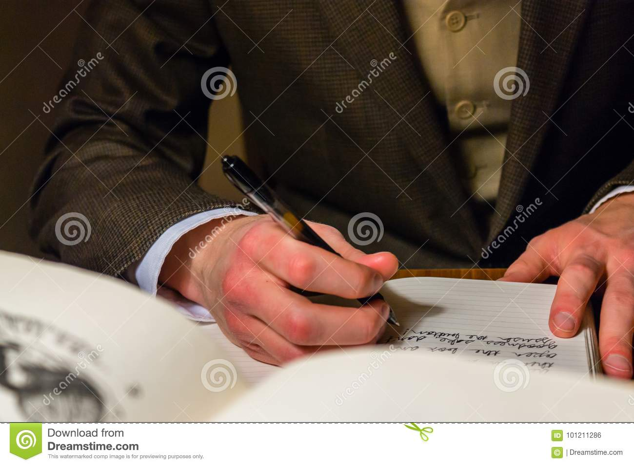 man writing a letter in a journal editorial photo image of mans