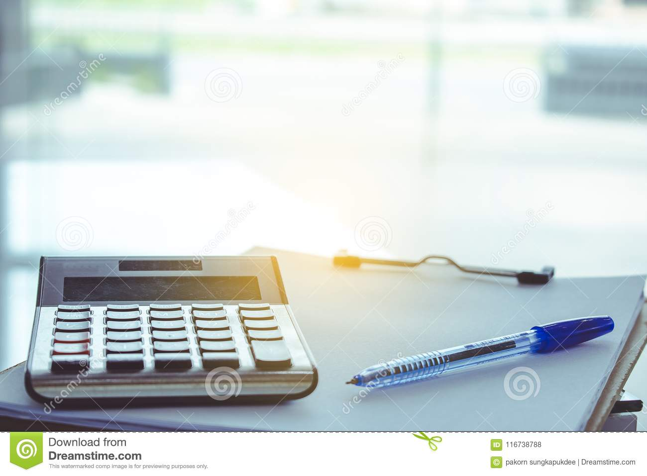 Man Writing On Notepad Or Note On Price List Blurry