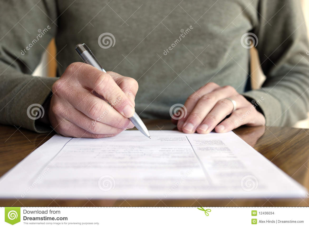 man-writing-paper-pen-table-12436034.jpg