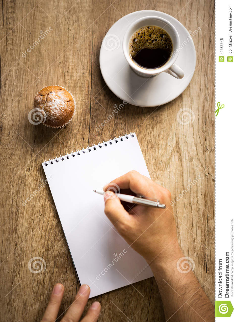 man writing on paper  top view stock photo