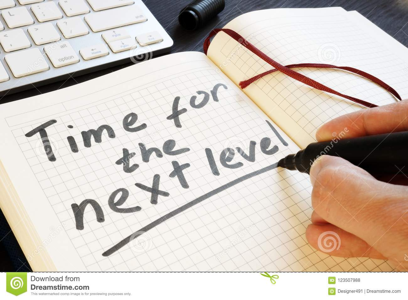 Man Is Writing Time For The Next Level Motivation Stock Photo