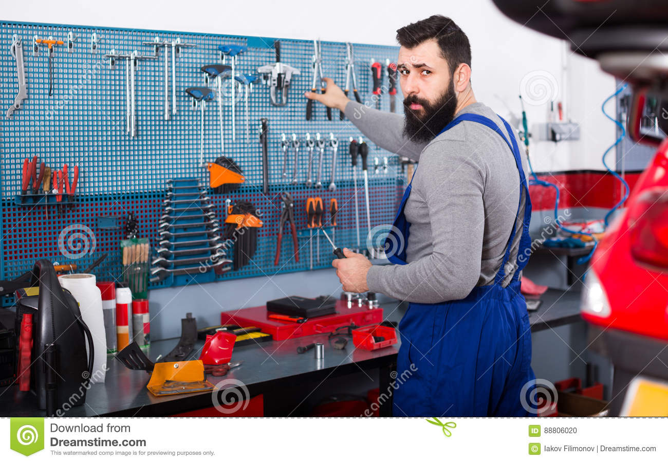 Man 30-35 years old is ready to use his tools
