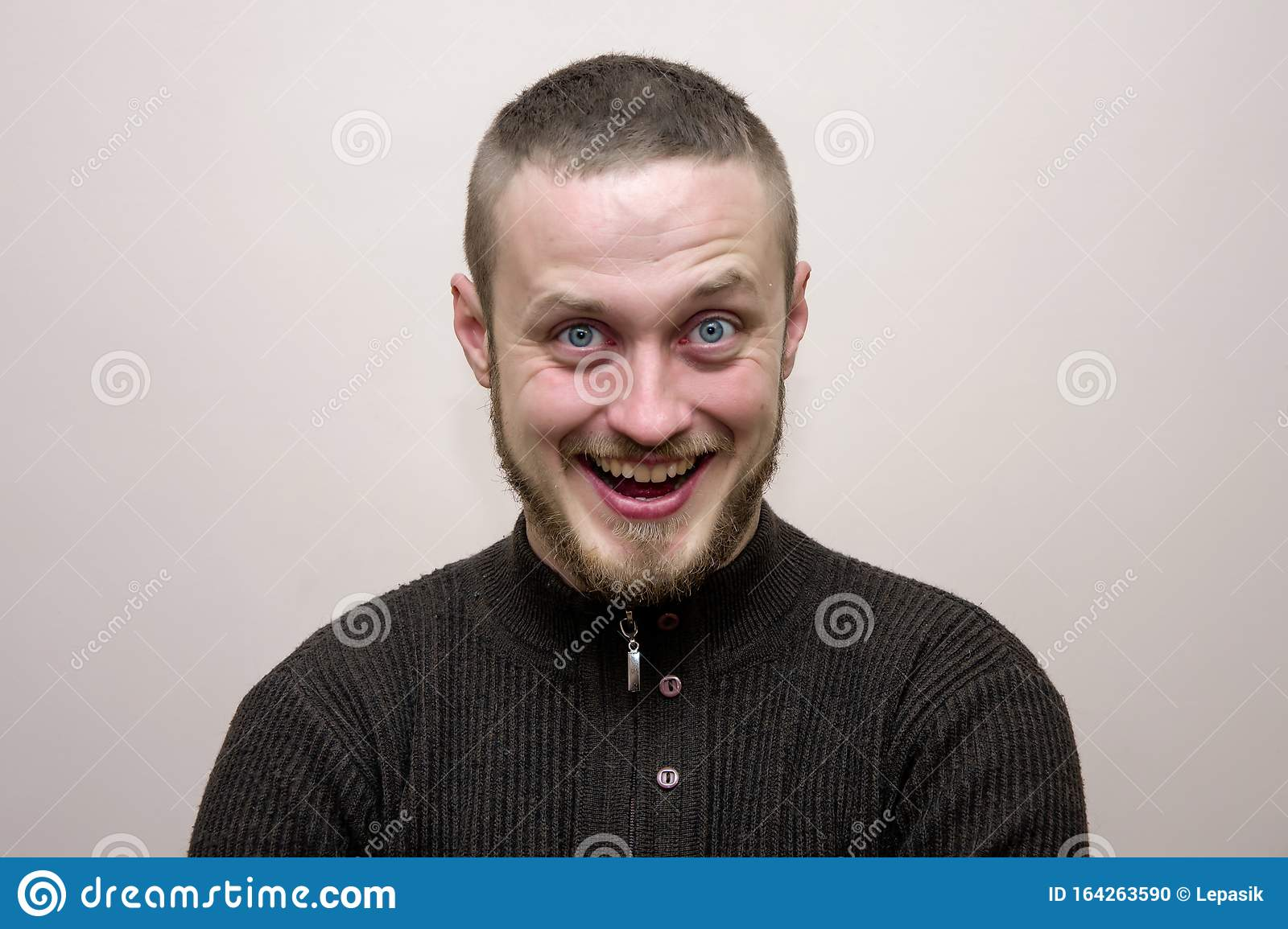 A Man Of 35 40 Years With A Short Haircut And Beard Very Much Rejoices And Admires Feelings And Emotions Of A Man Stock Photo Image Of Rejoices Handsome 164263590