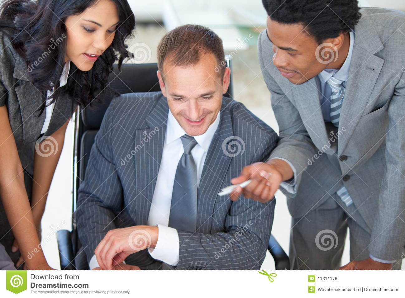manager with employees working in office royalty free