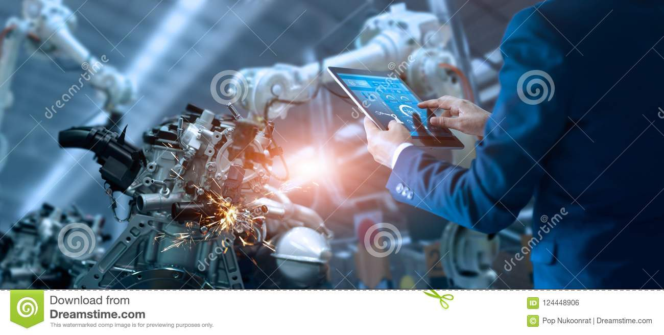 Manager engineer controlling automation robot arms machine