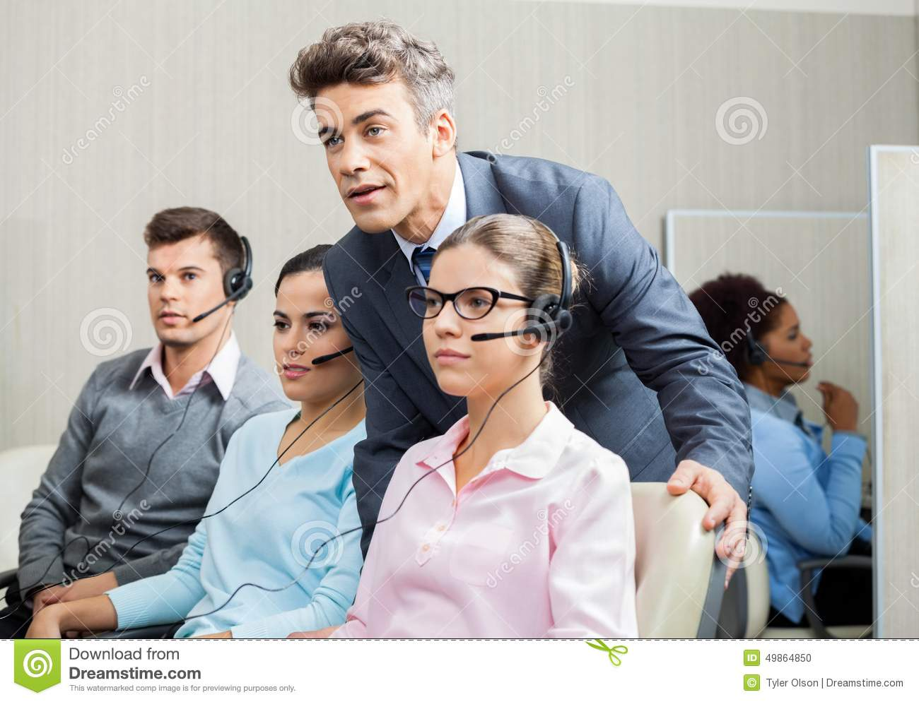 Manager Explaining To Employee In Call Center