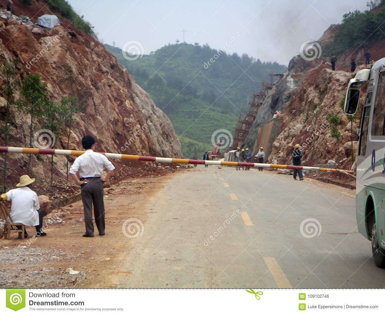 Manager observing road workers in China