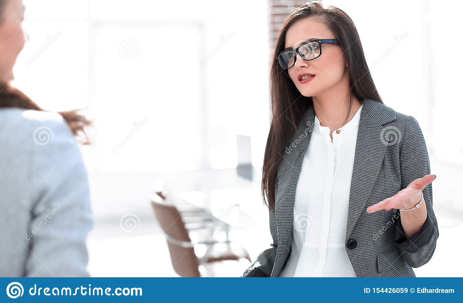 Manager talking with a client standing in the office
