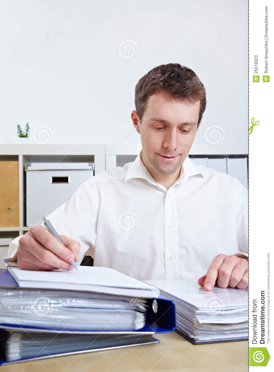 Manager Working At His Desk Stock Photos - Image: 25518323