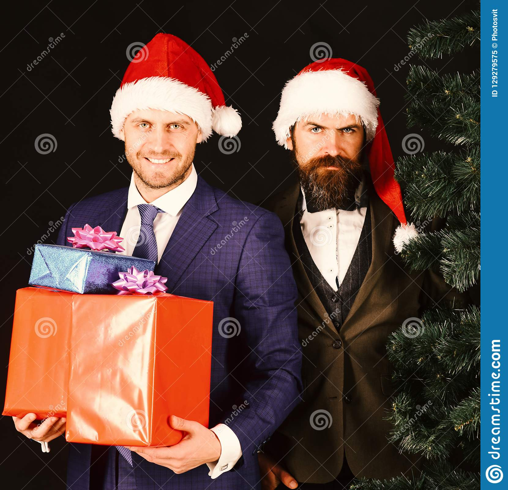 Managers with beards get ready for Christmas.