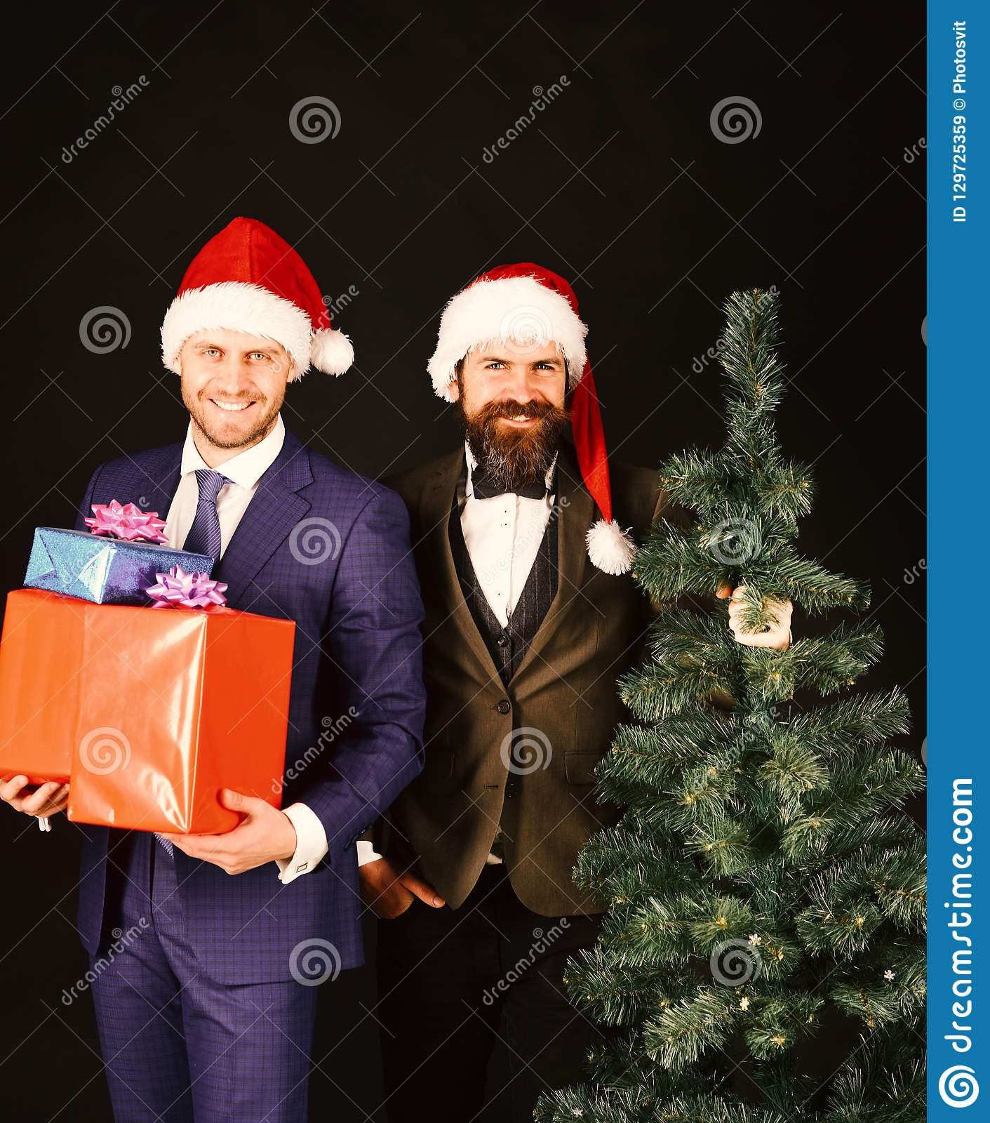 Managers with beards get ready for Christmas. Men in suits