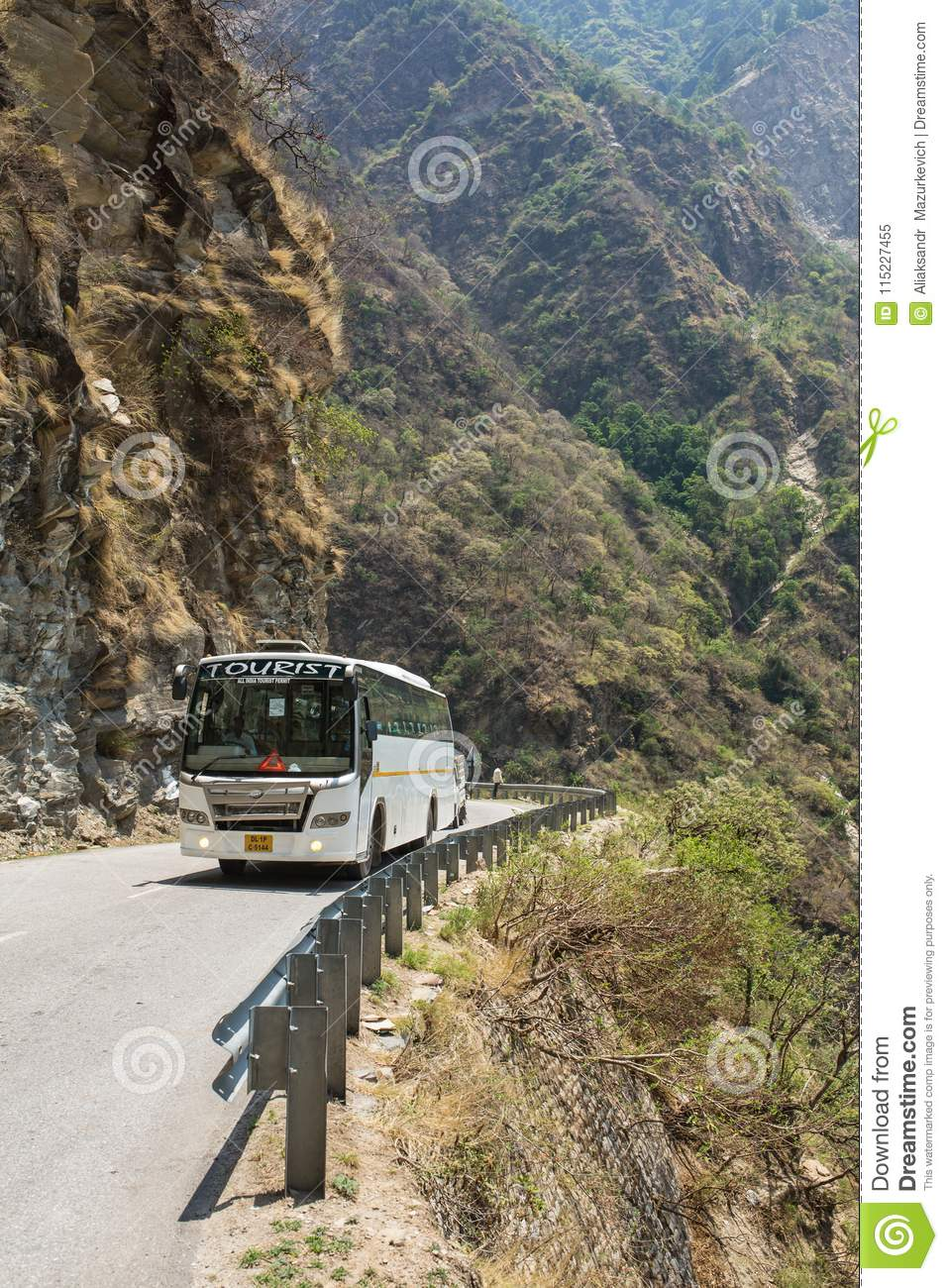 Tourist bus driving on dangerous mountain road in Himalayas on the way from Mandi to Manali