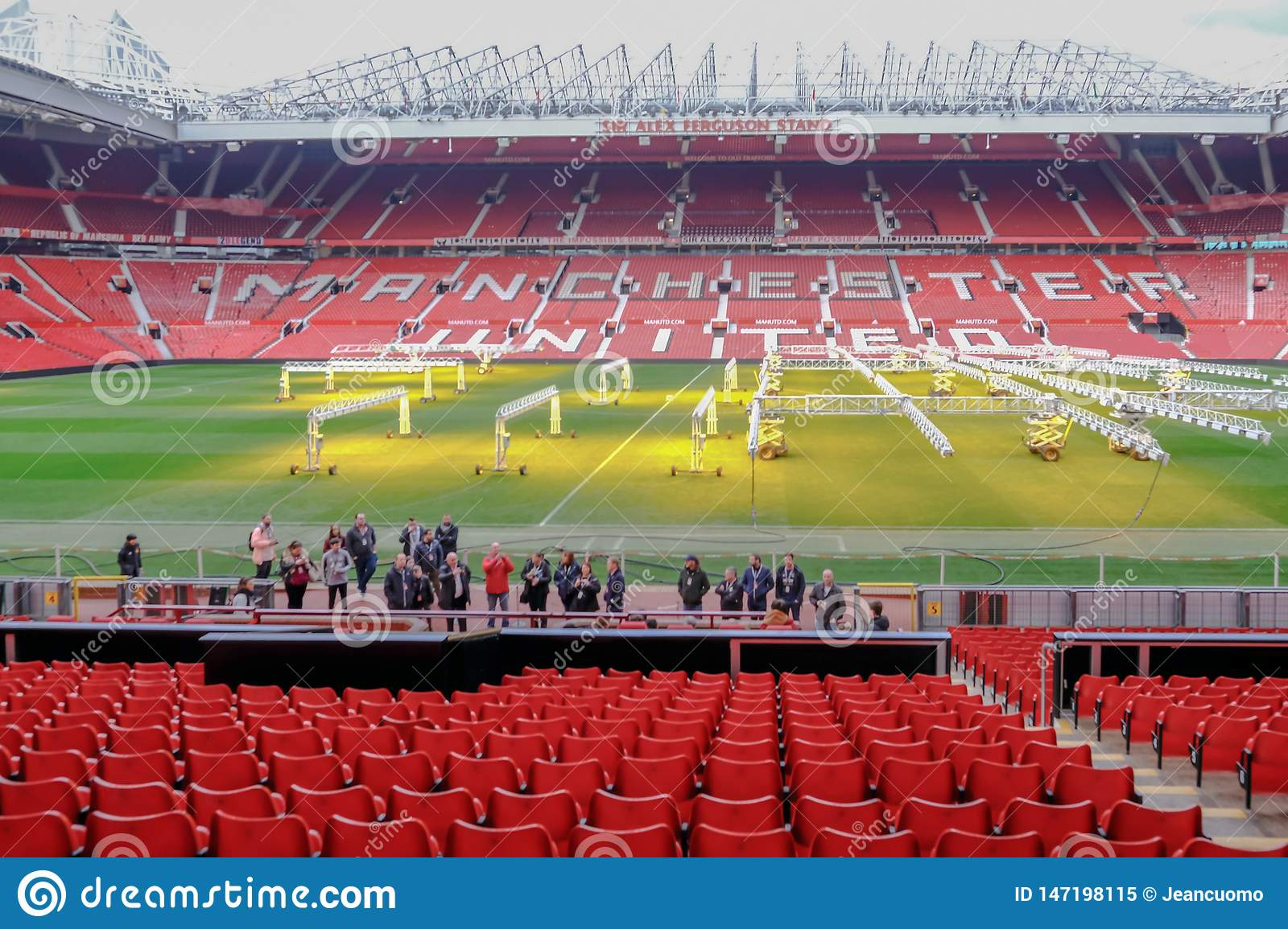 Manchester United S Old Trafford Stadium Seating Is Empty And The Pitch Is Having Light Treatment To Help Maintain The Grass Editorial Image Image Of Interior Editorial 147198115