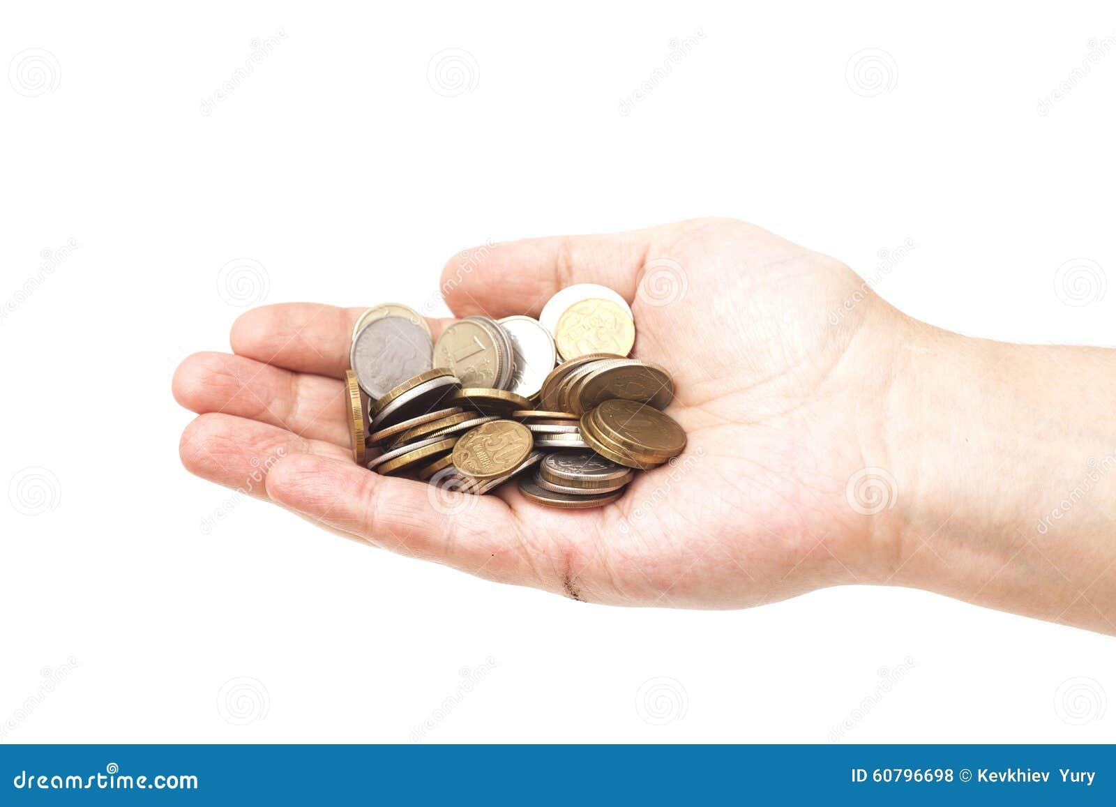 Manciata di monete in mano della palma