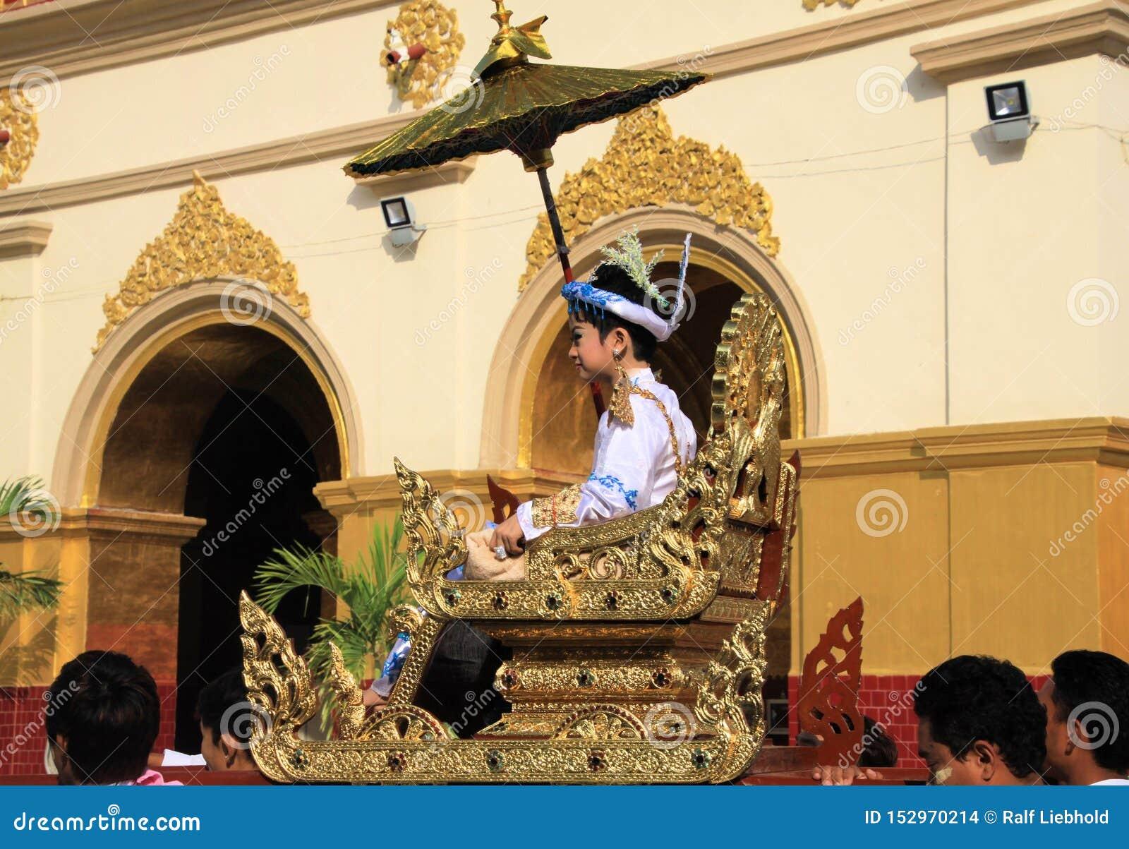 MANDALAY, MYANMAR - DECEMBER 18. 2015: Novitiation novitiate ceremony Shinbyu for young Buddhist boy on sedan chair at Maha
